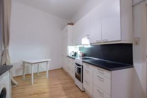 מטבח או מטבחון ב-Vienna Living Apartments - Stadtpark