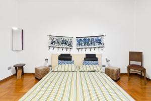Cama ou camas em um quarto em Padova Terrace Flat