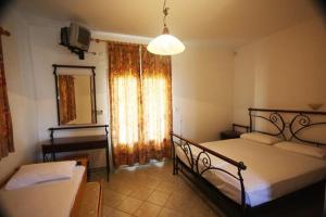 Una cama o camas en una habitación de Hotel Rigakis