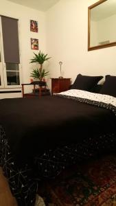 Giường trong phòng chung tại 17 Avenue de l'Agent Sarre