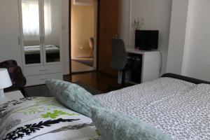 Una cama o camas en una habitación de Apartment Dunav