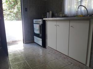 Una cocina o kitchenette en Duplex Tinkunaco