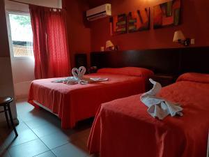 Una cama o camas en una habitación de Apart hotel piscu yaco