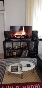 Uma TV ou centro de entretenimento em Modern appartment