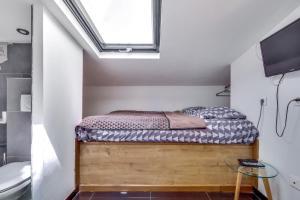 Una cama o camas en una habitación de Suite Eliot