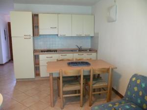 مطبخ أو مطبخ صغير في Residence de Tourisme Marina Corsa