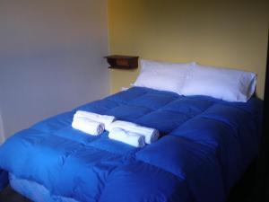 Una cama o camas en una habitación de Barranca Del Indio