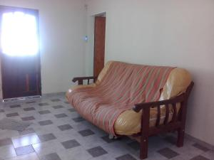 Uma área de estar em Casa soñada con vista a la Sierra de los Comechingones