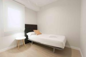 מיטה או מיטות בחדר ב-The Rentals Collection | Verona