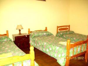 Una cama o camas en una habitación de La casa de Ray