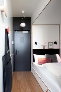 Cama ou camas em um quarto em Zoku Amsterdam