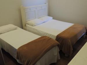 Cama ou camas em um quarto em Flat Coqueiros
