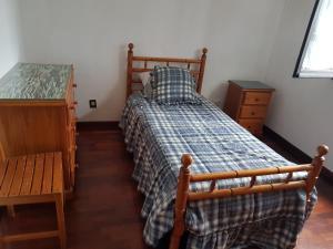 Giường trong phòng chung tại Casa do adro 2
