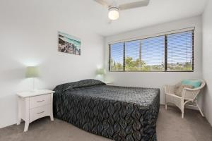 Una cama o camas en una habitación de Alexandria Apartments