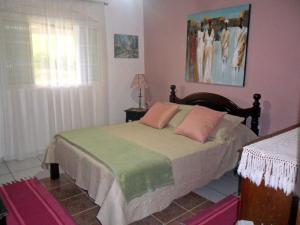 Cama ou camas em um quarto em Fazenda Monte Verde A Morada do Muriqui