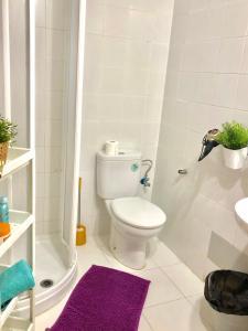 Um banheiro em City Apartment