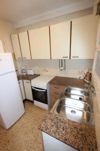 A cozinha ou cozinha compacta de Apartment Escor