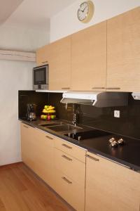 מטבח או מטבחון ב-Lady Hamilton Apartments