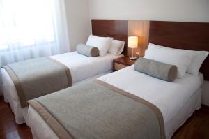 Cama ou camas em um quarto em Time Suite