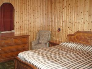 سرير أو أسرّة في غرفة في Villa Panorama