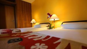 Cama ou camas em um quarto em Mansoori Apart Hotel II