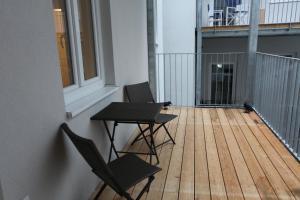 מרפסת או טרסה ב-Moderne Stadtwohnung mit Balkon