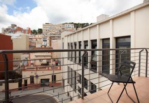 Uma varanda ou terraço em Guell Modern Apartment