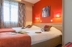 מיטה או מיטות בחדר ב-Résidence Pierre & Vacances Premium L'Amara