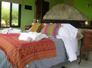 Una cama o camas en una habitación de Apart Los Antiguos