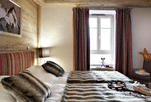 מיטה או מיטות בחדר ב-CGH Résidences & Spas Kalinda