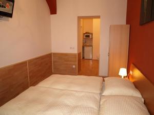 מיטה או מיטות בחדר ב-Pension Tal Studios