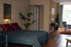 Una cama o camas en una habitación de Denneweg Apartment The Hague