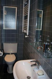Un baño de Denneweg Apartment The Hague
