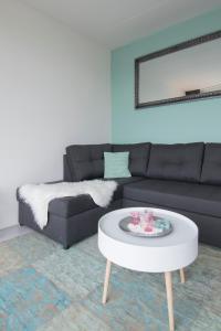 Uma área de estar em Appartement Zandvoort
