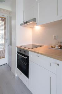 A cozinha ou cozinha compacta de Appartement Zandvoort