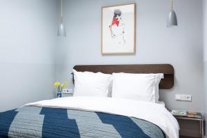 Cama ou camas em um quarto em Kith & Kin Boutique Apartments