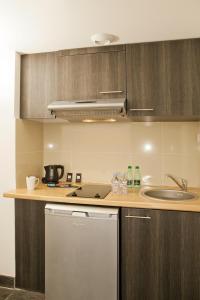 مطبخ أو مطبخ صغير في Residhome Suites Paris Sénart