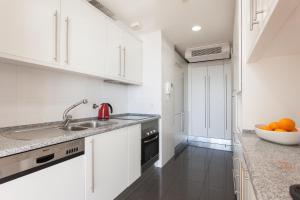 A cozinha ou cozinha compacta de Your Lisbon Home Oriente