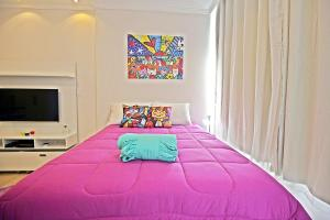 Cama ou camas em um quarto em C026