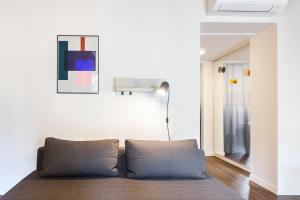מיטה או מיטות בחדר ב-Milano Suite - Downtown