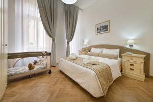 מיטה או מיטות בחדר ב-Hotel Suite Home Prague