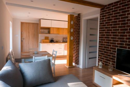 مطبخ أو مطبخ صغير في Apartamenty Sami Swoi