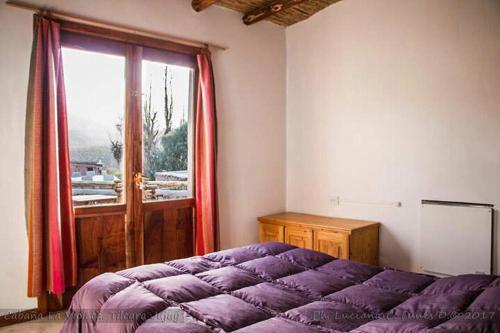 Una cama o camas en una habitación de La Violeta