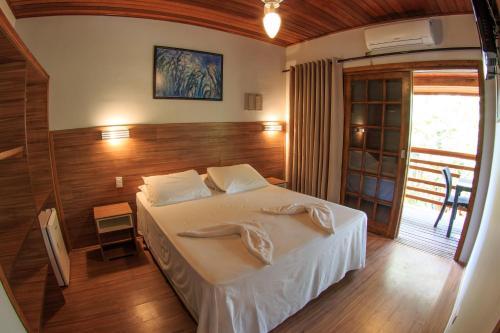 Cama ou camas em um quarto em Flat Vila Morena