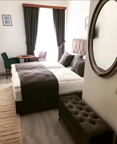 Cama ou camas em um quarto em Pension Babenberger