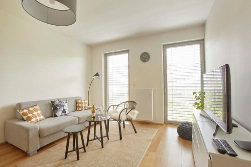 Uma área de estar em Modern Apartment
