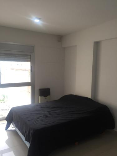 Una cama o camas en una habitación de Rodriguez Plaza