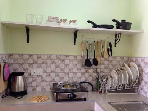 A cozinha ou cozinha compacta de The Three Shooting Stars