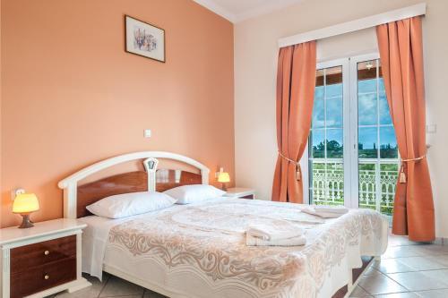 מיטה או מיטות בחדר ב-Villa Zerbera