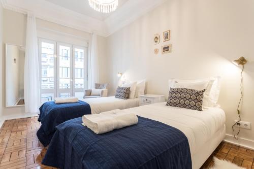 מיטה או מיטות בחדר ב-Cruz Apartments